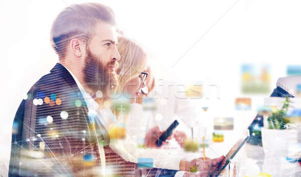 Businessman in office connected to internet network. concept of startup company. double exposure Stock photo © alphaspirit