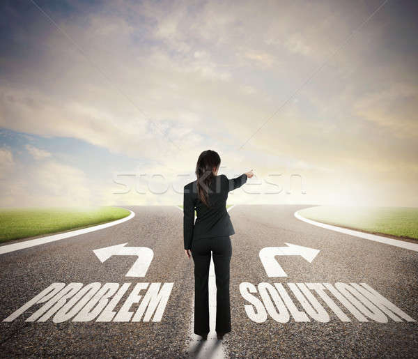 Businesswoman at a crossroads. She chooses the correct way. Concept of decision in business Stock photo © alphaspirit