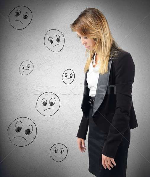Discouraged businesswoman Stock photo © alphaspirit