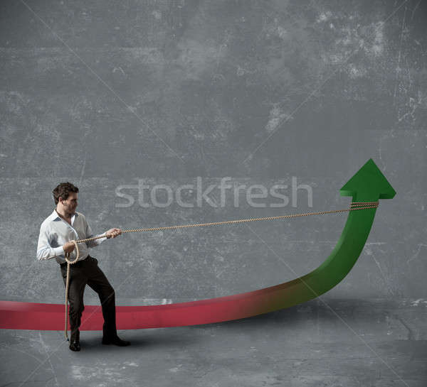 Businessman changes statistics Stock photo © alphaspirit