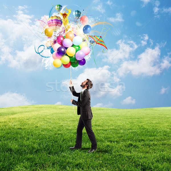 Creative businessman with colorful idea Stock photo © alphaspirit