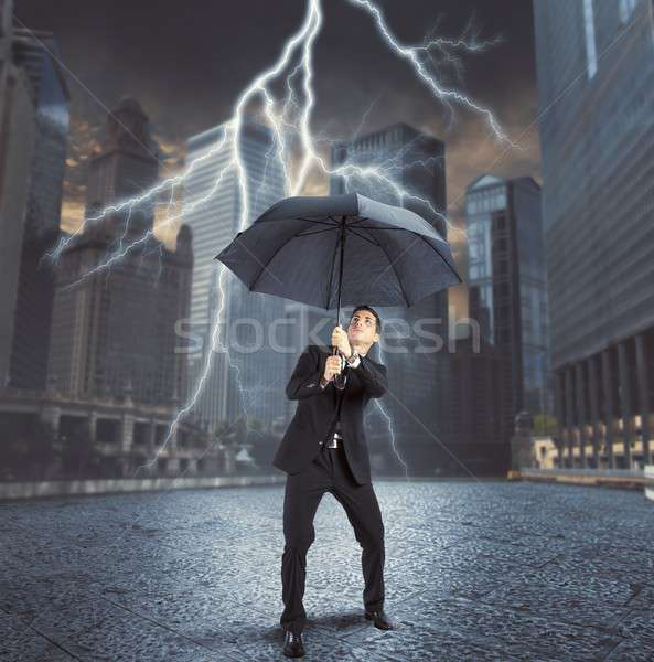Businessman against lightning Stock photo © alphaspirit