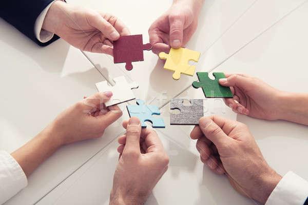 Trabalho em equipe parceria integração startup peças do puzzle empresários Foto stock © alphaspirit