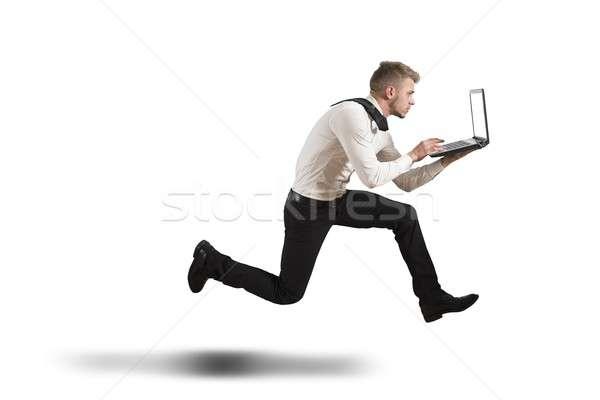 Konkurencja działalności uruchomiony biznesmen odizolowany komputera Zdjęcia stock © alphaspirit