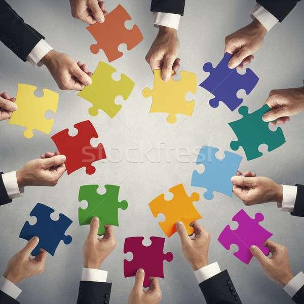 Csapatmunka integráció kirakó darabok üzlet kulcs játék Stock fotó © alphaspirit