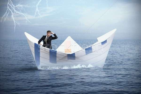 Fuggire crisi imprenditore carta barca business Foto d'archivio © alphaspirit