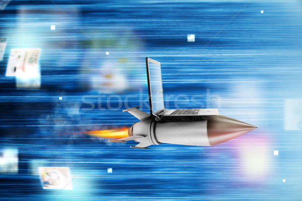 Fast internet concept with a laptop over a rocket Stock photo © alphaspirit