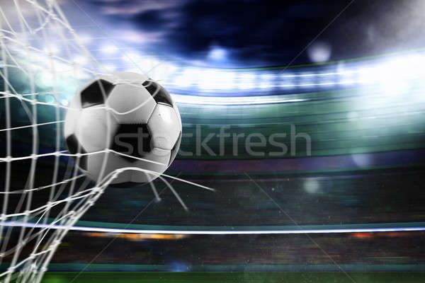 Soccer ball scores a goal on the net Stock photo © alphaspirit
