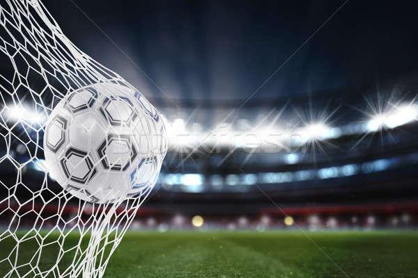 Soccer ball scores a goal on the net. 3D Rendering Stock photo © alphaspirit
