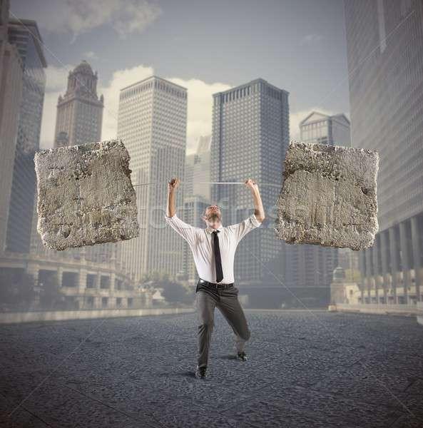 Difícil negócio atleta homem de negócios barbell pesado Foto stock © alphaspirit