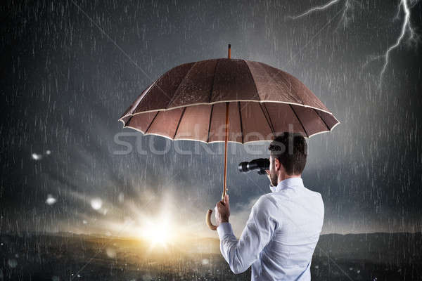 Stock photo: Businessman confident in a better future coming out of the financial and economic crisis