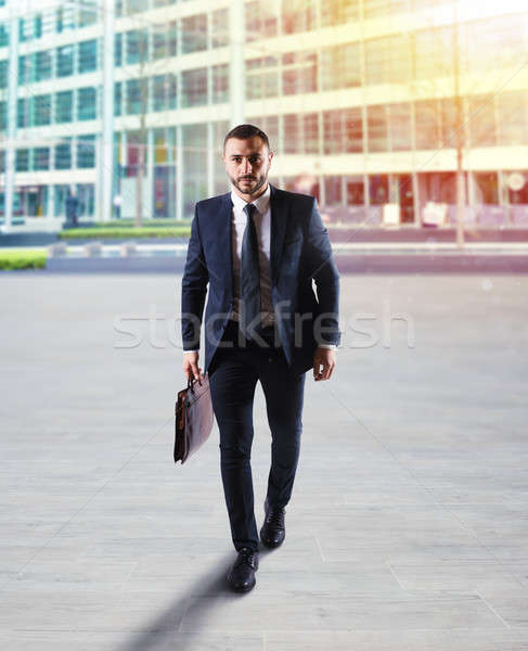 Determinated businessman walking in the city Stock photo © alphaspirit