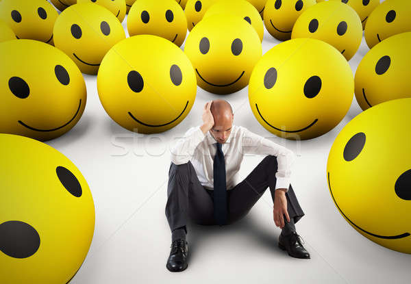 Alone desperate businessman in the middle of happy smileys . 3D Rendering Stock photo © alphaspirit