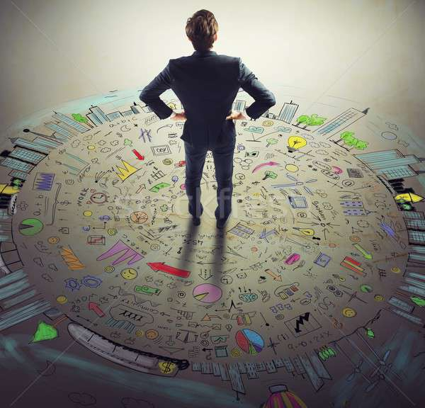 Businessman thinks business world Stock photo © alphaspirit