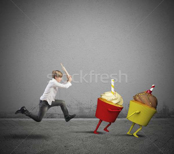 Child against the desserts Stock photo © alphaspirit