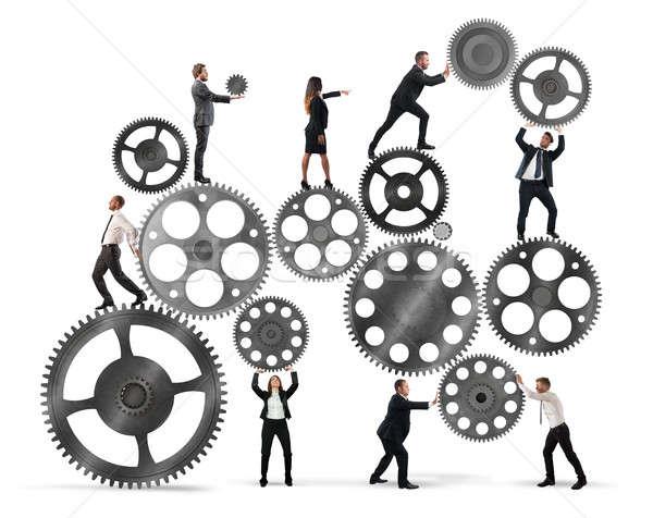 Teamwork of businesspeople Stock photo © alphaspirit