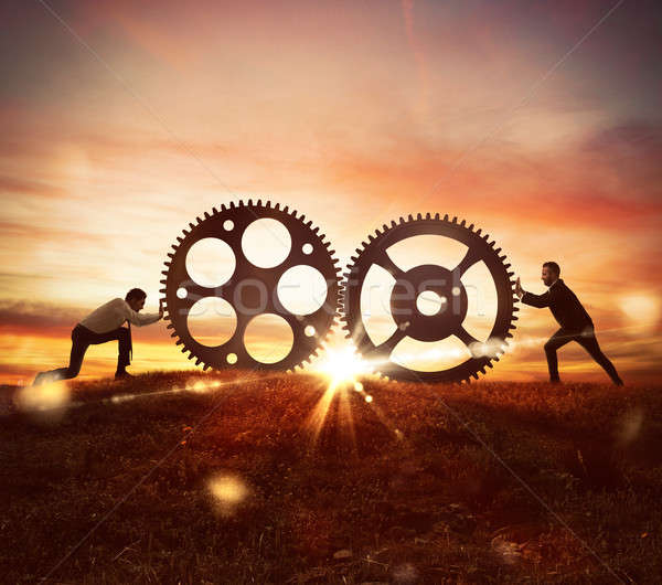 Cooperation at work concept with gears mechanism Stock photo © alphaspirit