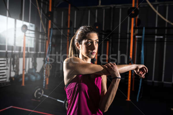 Athletic girl does stretching exercises at the gym Stock photo © alphaspirit