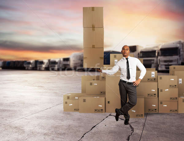 Stock photo: Businessman holds a pile of packages in a hand. concept of fast delivery