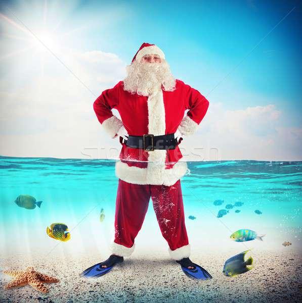 Santa Claus on vacation Stock photo © alphaspirit