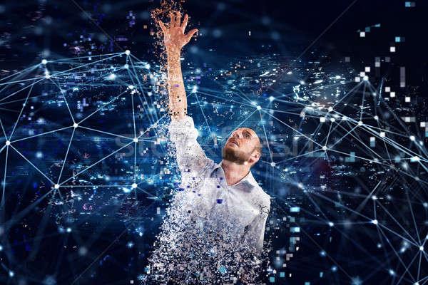 Captured businessman from internet technology. Concept of internet addiction Stock photo © alphaspirit