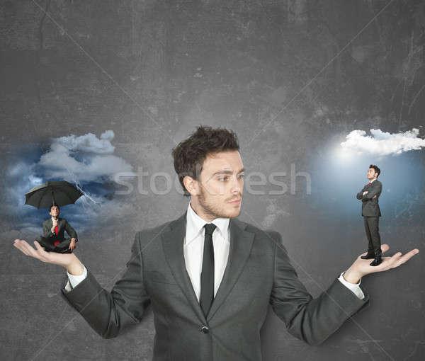 Positive negative Geschäftsmann zerrissen Hand Sonne Stock foto © alphaspirit