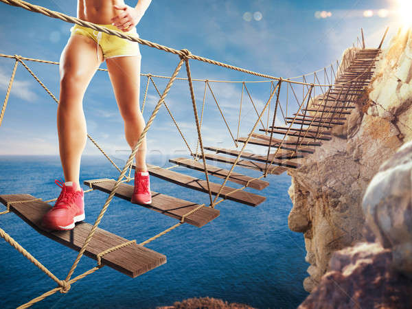 3D Rendering of trip on a crumbling bridge Stock photo © alphaspirit