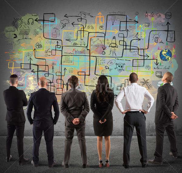 ビジネスチーム 図面 新しい 複雑な プロジェクト 壁 ストックフォト © alphaspirit