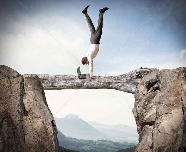 Equilibrist businessman Stock photo © alphaspirit