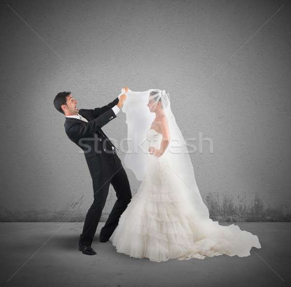Amazed husband lifts the veil of wife Stock photo © alphaspirit