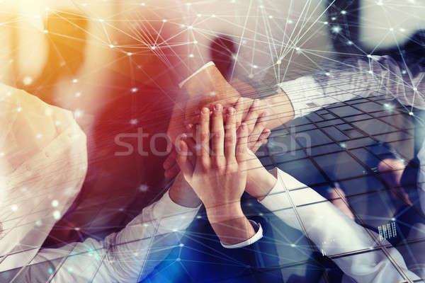 Business people joining hands in the office with network effect. concept of teamwork and partnership Stock photo © alphaspirit