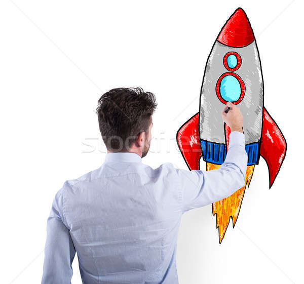 Businessman drawing a rocket. Concept of business improvement and enterprise startup Stock photo © alphaspirit