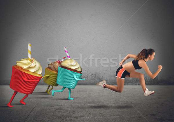 Woman runs away from sweets Stock photo © alphaspirit