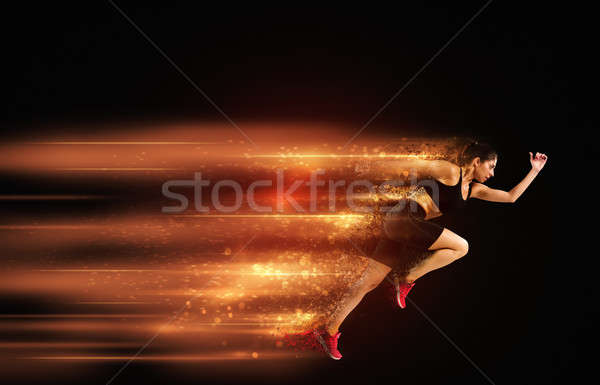 Athletic woman fast runner Stock photo © alphaspirit