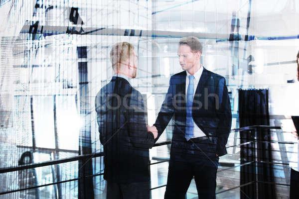 Işadamı konuşmak ofis çift maruz kalma modern Stok fotoğraf © alphaspirit