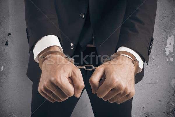 üzletember megbilincselve börtön kéz férfi törvény Stock fotó © alphaspirit