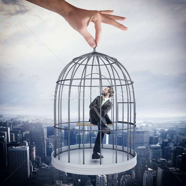 Caged  businessman Stock photo © alphaspirit