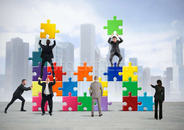 Team of businesspeople build a new company Stock photo © alphaspirit