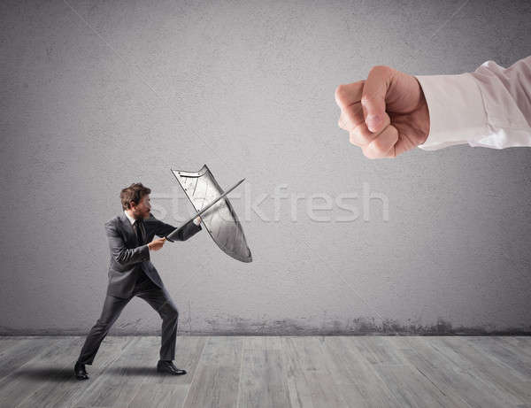 Little business man challenges big problems fighting with shield and sword Stock photo © alphaspirit