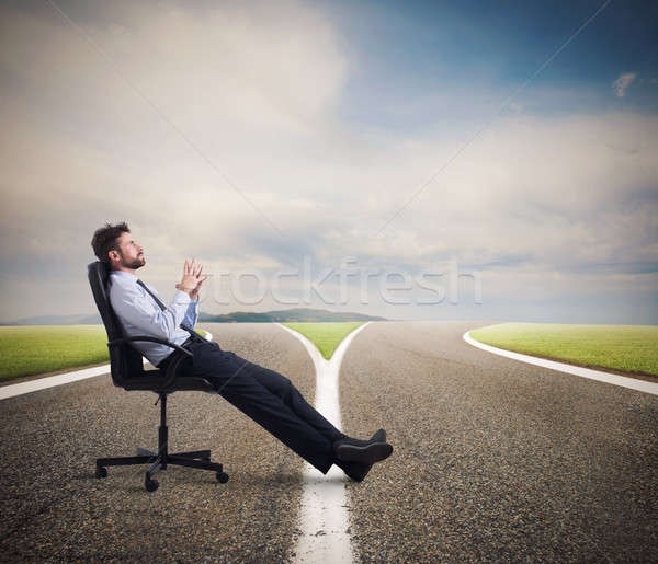 Difficult choices of a businessman at a crossroads. concept of confusion Stock photo © alphaspirit