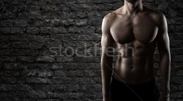 Muscular of a body building trainer man Stock photo © alphaspirit