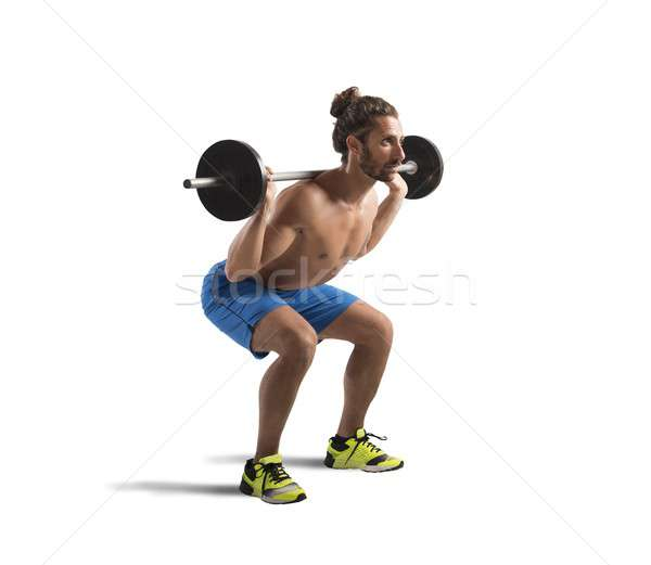 Workout with barbell Stock photo © alphaspirit