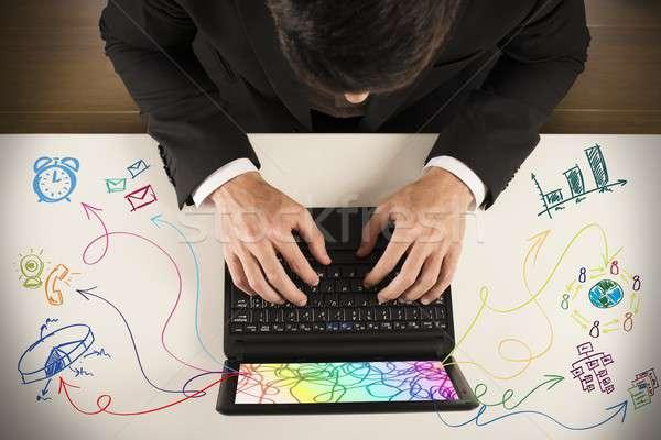 Multitasking imprenditore lavoro notebook diverso compito Foto d'archivio © alphaspirit