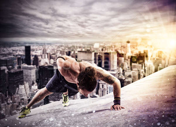 Workout  above the roof of a building in the city Stock photo © alphaspirit