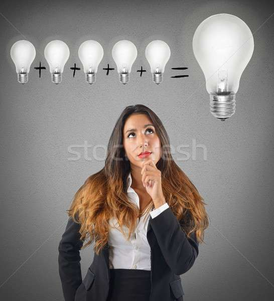 Businesswoman sum various ideas for a brilliant idea Stock photo © alphaspirit