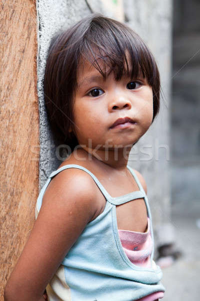 Philippines - young girl against wall Stock photo © alptraum