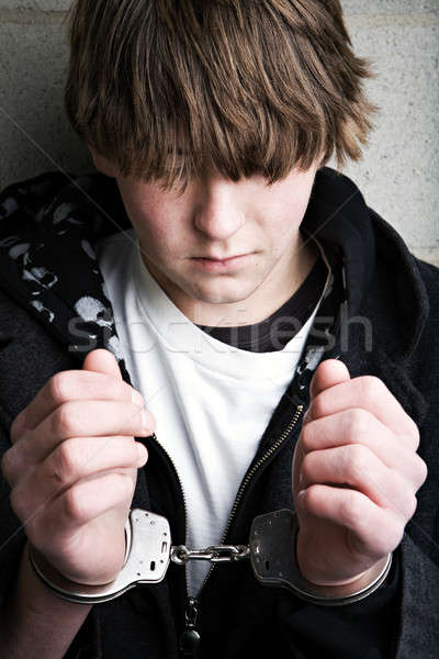 teen crime - kid in handcuffs Stock photo © alptraum