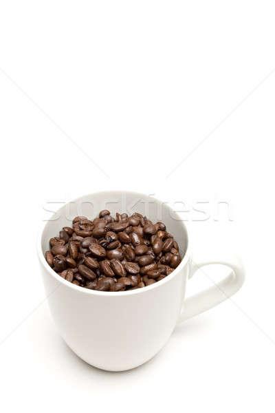 Csésze kávéscsésze kávé egész bab közelkép Stock fotó © alptraum