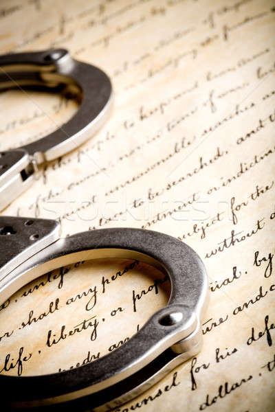 handcuffs on constitution Stock photo © alptraum