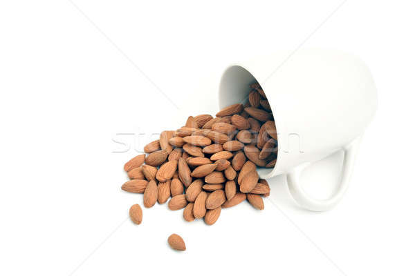 hazelnuts spilt from cup Stock photo © alptraum